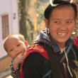 图库照片: Hmong tribe womwith child, Sapa, Vietnam