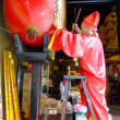 Stock Photo: Taoist priest hitting temple drum, A-Mtemple, Macau