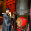 Stock Photo: Taoist priest hitting temple bell, A-Mtemple, Macau