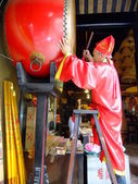 Taoist priest hitting temple drum, A-Ma temple, Macau — Stock Photo