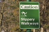 Slippery Walkways sign — Stock Photo