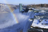 Niagara Falls and Rainbow Bridge in winter, New York, USA — Stock Photo