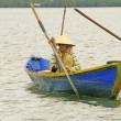Local woman in a boat, Ream National Park, Cambodia - Stock Photo
