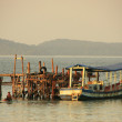Wooden jetty and fishing boat, Koh Rong Samlon island, Cambodia — Stock Photo