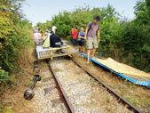Tourists riding bamboo train, Battambang, Cambodia — Stock Photo