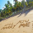 Words Will you marry me on a beach — Stock Photo