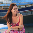 Young woman sitting at Boca Chica boat pier — Stock Photo