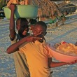 Local boys selling bread at Boca Chica beach — Stock Photo