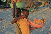 Local boys selling bread at Boca Chica beach — Stock Photo