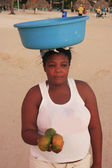 Local woman selling fruits at Boca Chica beach — Stock Photo