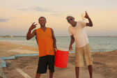 Local men having party at Boca Chica beach — Stock Photo