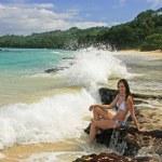 Young woman in bikini sitting on rocks at Rincon beach, Samana p — Stock Photo #25901879
