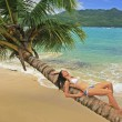 Young woman in bikini laying on leaning palm tree at Rincon beac — Stock Photo #25905225