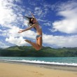 Young woman in bikini jumping at Rincon beach, Samana peninsula — Stock Photo