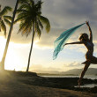 Silhouette of young woman jumping at Las Galeras beach — Stock Photo
