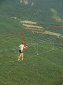 Man walking on a rope at Ai-Petri summit, Crimea — Stock Photo