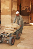 Local man working at Karnak temple complex, Luxor — Stock Photo