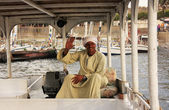 Egyptian captain driving his boat on the Nile river, Luxor — Stock Photo