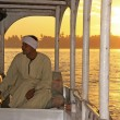 Egyptian captain driving his boat on the Nile river at sunset, L — Stock Photo
