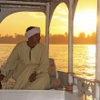 Egyptian captain driving his boat on the Nile river at sunset, L — Lizenzfreies Foto