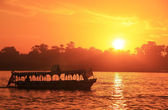 Boat cruising the Nile river at sunset, Luxor — Stock Photo