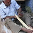 Stock Photo: Indian man working with wood in the street, Bundi, India
