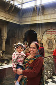 Indian woman with a girl standing inside of Karni Mata Temple, D — Stock Photo