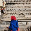 Stock Photo: Indian woman walking around Jagdish temple, Udaipur, India