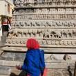 Indian woman walking around Jagdish temple, Udaipur, India — Stock Photo