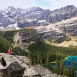 Young woman admiting Lake O'Hara, Yoho National Park, Canada — Stock Photo
