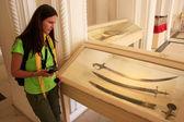Tourist looking at display of swords, Mehrangarh Fort museum, Jo — Stock Photo