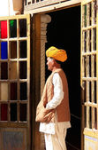 Indian man standing by the doorway at Mehrangarh Fort, Jodhpur, — Stock Photo