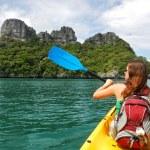Young woman kayaking in Ang Thong National Marine Park, Thailand — Stock Photo #40813461