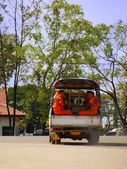 Buddhist monks riding in tuk-tuk, Vientiane, Laos — Foto de Stock