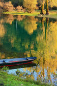 Boat at Crnojevica river with colorful trees reflection, Montene — Stock Photo