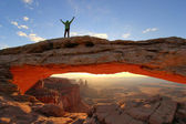 Silhouetted person standing on top of Mesa Arch, Canyonlands Nat — Stock Photo