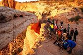 Photographers and tourists watching sunrise at  Mesa Arch, Canyo — Stock Photo
