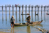 Local men in a boat near U Bein Bridge, Amarapura, Myanmar — Stock Photo
