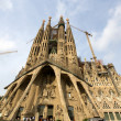 Stock Photo: BARCELONA, SPAIN - SEPTEMBER 10: Exterior of SagradFamili- impressive cathedral designed by Gaudi, is being build since 1882 and is not finished yet September 10, 2012 in Barcelona, Spain.