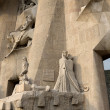 BARCELONA, SPAIN - SEPTEMBER 10: Sculptures on SagradFamili- impressive cathedral designed by Gaudi, is being build since 1882 and is not finished yet September 10, 2012 in Barcelona, Spain. — Foto Stock #14073005