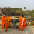 Stock Photo: Buddhist monks near temple
