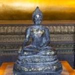 Stone buddha indside the Wat Pho temple in Bangkok — Stock Photo #40293619