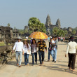 Unidentified tourists visit Angkor Wat — Stock Photo