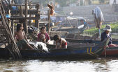 Boat with people near the settlement on the Mekong River, Vietnam — Stock Photo