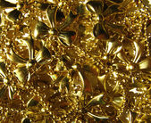 Background with festive gold bows — Stock Photo