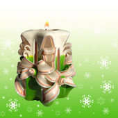 Christmas candle in white green lights on snowy background — Stok fotoğraf