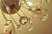 Decorations on ceilings - crystal chandeliers with bokeh — Stock Photo