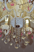 Chic crystal chandelier in white and pink colors — Stock Photo