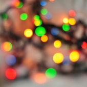 Abstract holiday background, Christmas lights in bright colors — Stock Photo