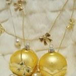 Christmas decoration - two golden balls on white fur, bows, pear — Stock Photo